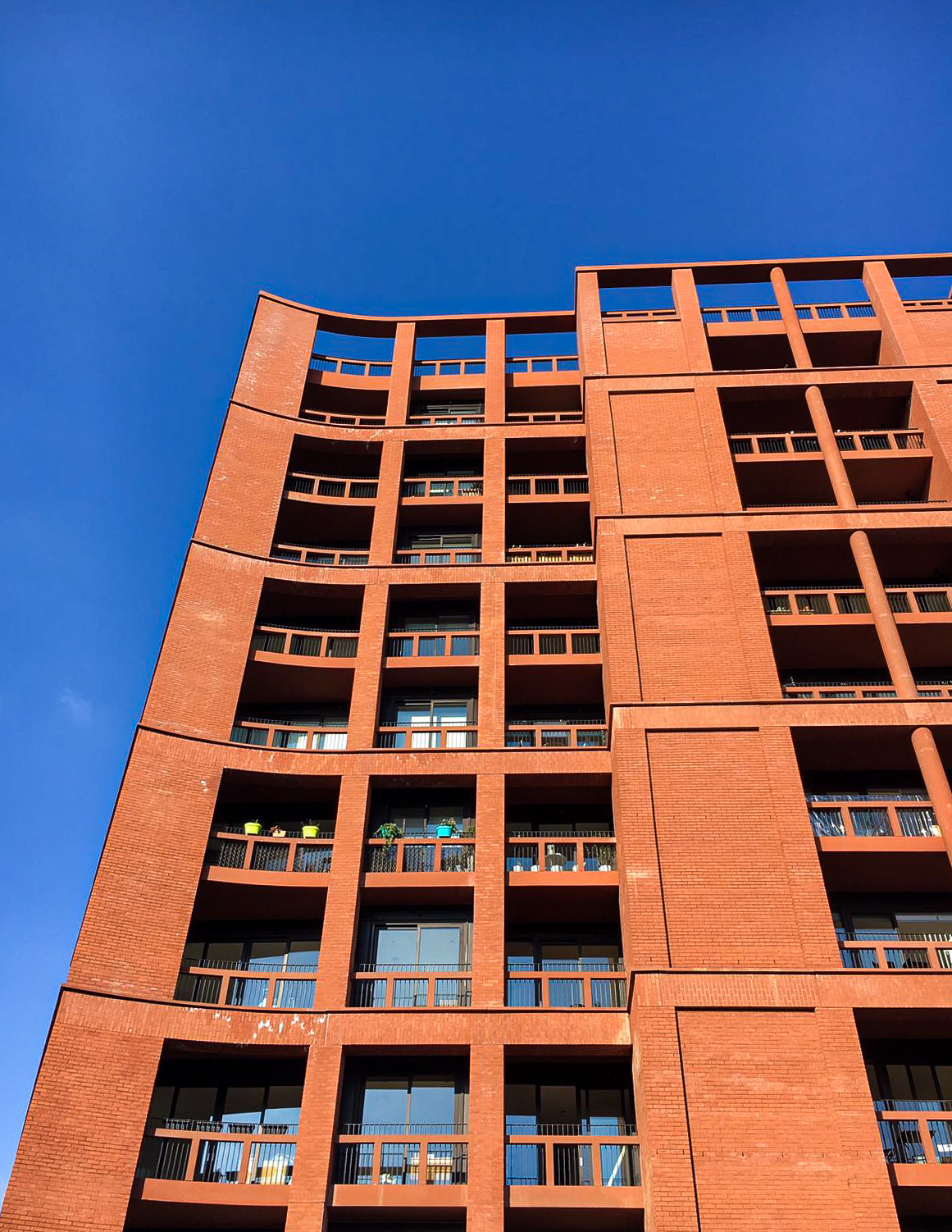 A red coloured building showing balconies