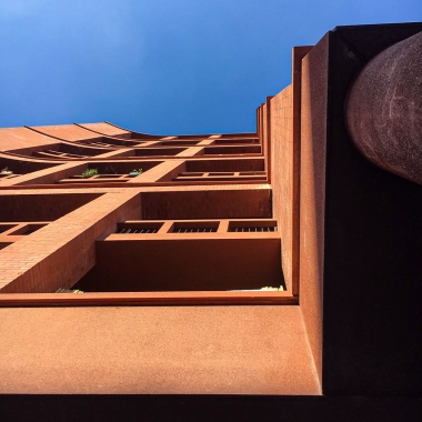 A view of a red sandstone building on a sunny day